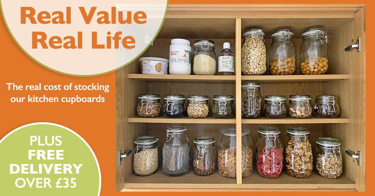 wholefoods in glass jars in cupboard